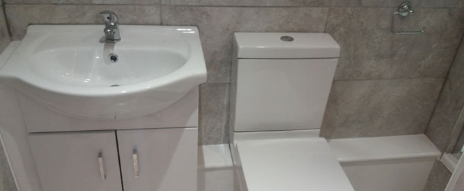 A simple double ensuite toilet and basin pictured